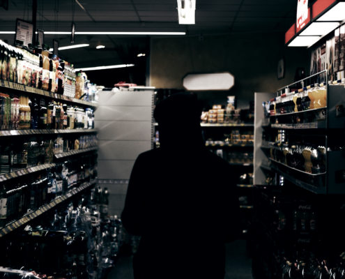 man in dark store